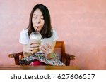 relaxed asian woman use smart... | Shutterstock . vector #627606557