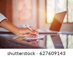 hand of businessman writing on