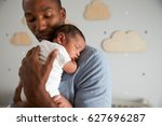 father holding newborn baby son ... | Shutterstock . vector #627696287