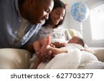 parents home from hospital with ... | Shutterstock . vector #627703277
