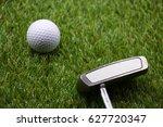 golf ball and putter on green...   Shutterstock . vector #627720347