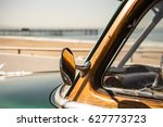 woody surf classic car in... | Shutterstock . vector #627773723