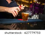 alcohol cocktail on the bar.... | Shutterstock . vector #627779753