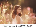 young girl in a flower field | Shutterstock . vector #627812633