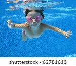 child swimming underwater in... | Shutterstock . vector #62781613