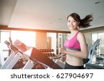 woman runs on treadmill in the... | Shutterstock . vector #627904697