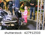 Small photo of A small visitor at a motor depot. St. Petersburg Russia - 15 April, 2017. International Motor Show IMIS-2017 in Expoforum. Visitors and participants of the annual moto-salon in St. Petersburg.
