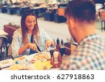young couple having lunch at a... | Shutterstock . vector #627918863