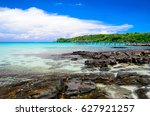 Small photo of Enjoin a good summer time on the beach with clear water and blue sky at Bang Bao Beach on Koh Kood island in Gulf of Thailand