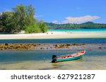 Small photo of Walking along the beach with shallow clear water to enjoin a good summer time at Klong Chao Beach on Koh Kood island in Gulf of Thailand