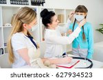 family doctor with patient | Shutterstock . vector #627934523