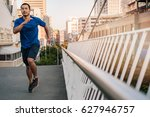 athletic young asian man in... | Shutterstock . vector #627946757