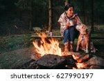 woman and beagle dog warm near... | Shutterstock . vector #627990197