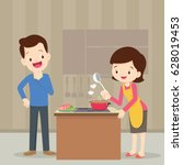 man and woman in the kitchen... | Shutterstock .eps vector #628019453