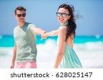 happy young couple in honeymoon ... | Shutterstock . vector #628025147
