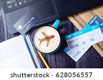 laptop  plane tickets  coffee ...   Shutterstock . vector #628056557