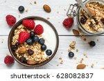 bowl of oat granola with yogurt ... | Shutterstock . vector #628082837