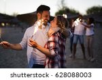 happy group of friends lighting ... | Shutterstock . vector #628088003