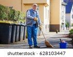 elderly senior man with broom...   Shutterstock . vector #628103447