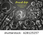 french cuisine top view frame.... | Shutterstock .eps vector #628125257