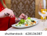 woman in red eats salad natural....   Shutterstock . vector #628136387