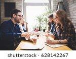 happy colleagues from work... | Shutterstock . vector #628142267