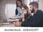 happy creative coworkers... | Shutterstock . vector #628142297