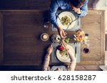 romantic man giving a rose to... | Shutterstock . vector #628158287