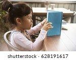 little child reading book | Shutterstock . vector #628191617