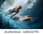 underwater shot of the couple... | Shutterstock . vector #628222793