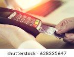 female hand inserting credit