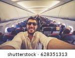 handsome man taking selfie with ...   Shutterstock . vector #628351313