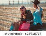 two girls walking with shopping ... | Shutterstock . vector #628418717
