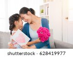 young asian mother accepting...   Shutterstock . vector #628419977