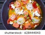 sevice with salmon and mango | Shutterstock . vector #628444043