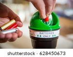 man putting used batteries into ...   Shutterstock . vector #628450673