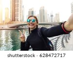 young woman tourist laughing... | Shutterstock . vector #628472717