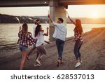 happy group of friends lighting ... | Shutterstock . vector #628537013