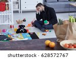overwhelmed young dad sitting... | Shutterstock . vector #628572767