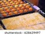 takoyaki in the making | Shutterstock . vector #628629497