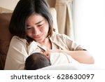 mother breastfeeding her... | Shutterstock . vector #628630097