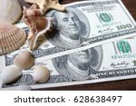 money and seashells  as a... | Shutterstock . vector #628638497