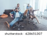 positive colleagues riding in... | Shutterstock . vector #628651307