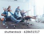 positive colleagues having fun... | Shutterstock . vector #628651517