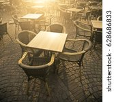 cafe table at sunset | Shutterstock . vector #628686833