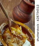 Small photo of Russian real Rustic cabbage soup shchi