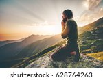 man praying at sunset mountains ... | Shutterstock . vector #628764263