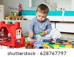 boy play with colored cubes   Shutterstock . vector #628767797