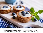 nutritious granola cups filled... | Shutterstock . vector #628847927