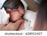 mother breastfeeding her... | Shutterstock . vector #628921427